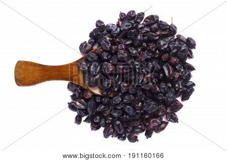 Dried barberry in spoon on white background