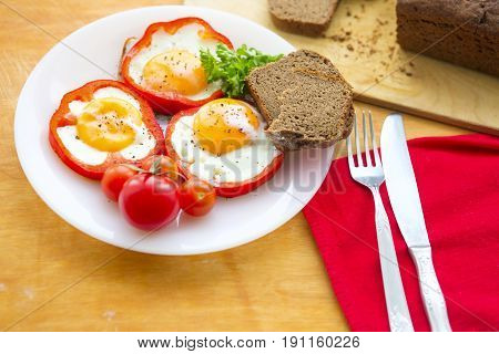 Fried Eggs In Red Peppers