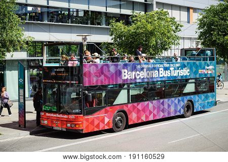 BARCELONA, SPAIN - MAY 2017: Tourists are driving on City tour excursion bus in Barcelona town, Spain