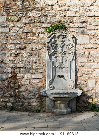 Marble sculpted drinking fountain at Gulhane Park Sultan Ahmet district Istanbul Turkey