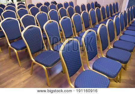 Empty Conference Chairs In Row At A Business Room