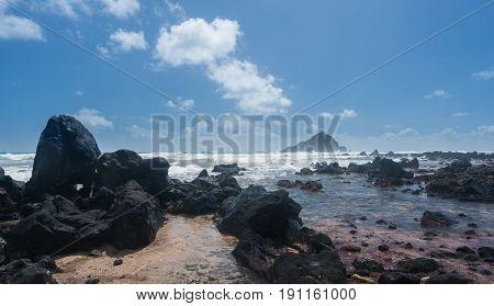 Waves break on Koki beach near Hana on Hawaiian island of Maui