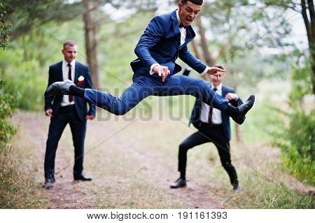 Awesome Groom And Groomsmen Getting Crazy In The Forest And Performing Tricks On A Wedding Day.