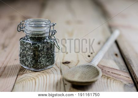 Spice In A Jar On A Wooden Table, Wooden Spoon