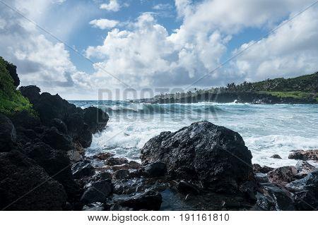 Black sand beach at Waianapanapa State Park on the road to Hana in Maui, Hawaii