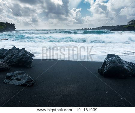 Black sand beach at Waianapanapa State Park on the road to Hana in Maui, Hawaii