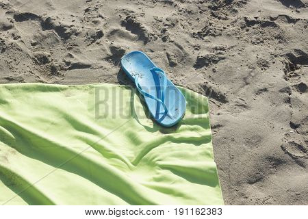 Towel And Sandals On Beach