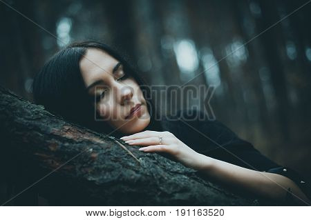 Portrait Of A Beautiful Mysterious Woman In The Forest. Cold Toning