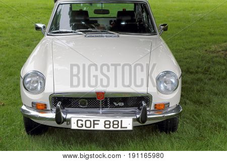 Beaulieu, Hampshire, Uk - May 29 2017: Front View Of A White 1972 Mg Mgb Gt V8