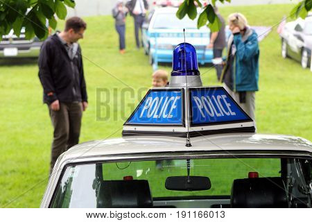 Beaulieu, Hampshire, Uk - May 29 2017: Police Insignia And Blue Flashing Light On Top Of A White 197