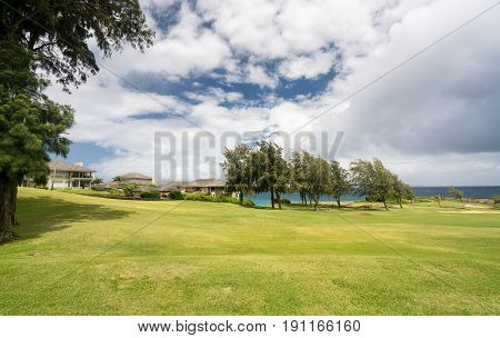 Coastline and housing development on golf course with large luxury single family homes at Makaluapuna Point near Kapalua, Maui, HI, USA