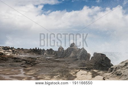Coastline and rugged lava rocks called Dragons Teeth at Makaluapuna Point near Kapalua, Maui, HI, USA