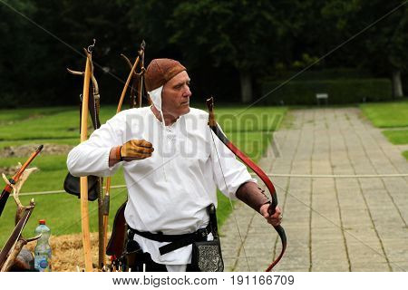 Beaulieu, Hampshire, Uk - May 29 2017: Traditional Archer With Vintage Bow Demonstrating Archery
