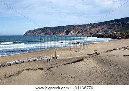 GUINCHO, PORTUGAL - SEPTEMBER 22, 2016: End of summer with a few people enjoying the surf at the Guincho Beach near Lisbon Portugal.