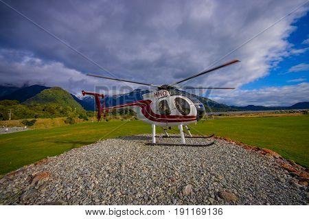 SOUTH ISLAND, NEW ZEALAND- MAY 25, 2017: A helicopter ready to take tourists to a Franz Josef Glacier National Park, Westland, New Zealand.