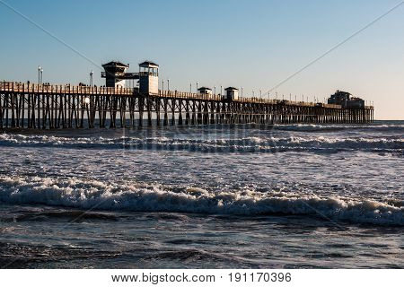 OCEANSIDE, CALIFORNIA - MARCH 23, 2017:  The west coast's longest wooden over-water fishing pier at 1954 feet is found in San Diego County.