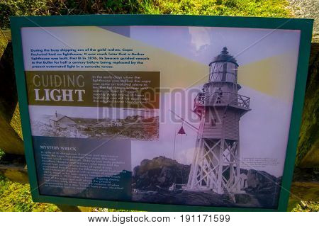 SOUTH ISLAND, NEW ZEALAND- MAY 23, 2017: An informative sign of the Lighthouse at Cape Foulwind, West Coast of South island, New Zealand.