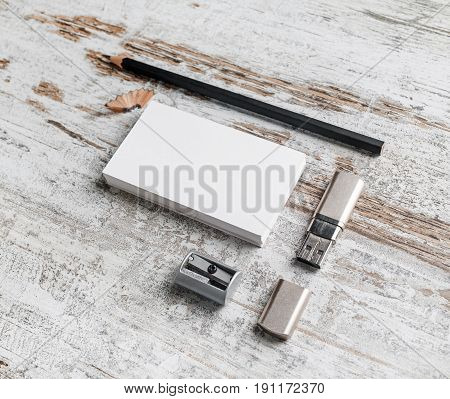 Photo of blank business cards pencil eraser flash drive and sharpener on vintage wood background. Responsive design template. Mock-up for ID.