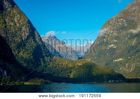landscape of high mountain glacier at milford sound with a beautiful lake, in south island in New Zealand.