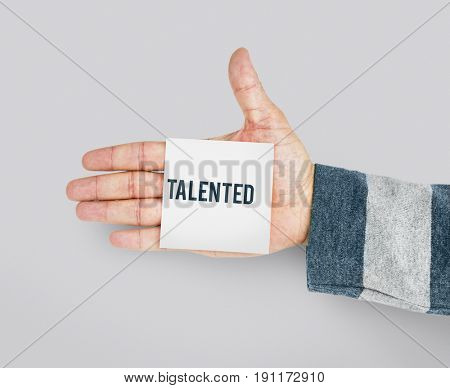 Hand with Sticky Note Showing Talented Skills Word