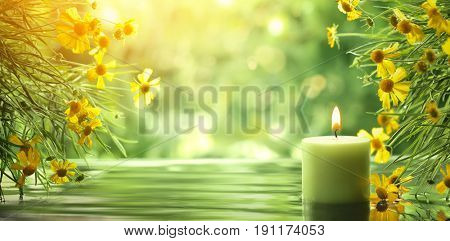 Spa concept with burning candle and flower