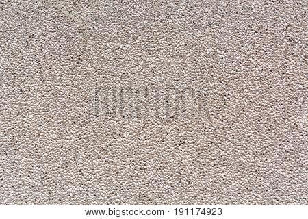 Texture of a porous brick. Background of a porous brick. Gray brick.