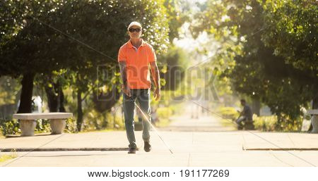 Blind Man Crossing The Street And Walking With Cane