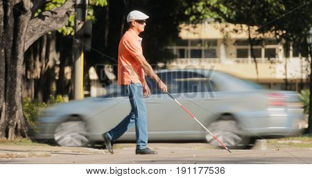 Blind Man Crossing The Road With Cars And Traffic