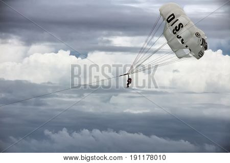Punta Cana, Dominican Republic - July 03, 2016: Para-sailing in sky covered with clouds. Para-sailing is a popular recreational activity among tourists in Punta Cana resorts.