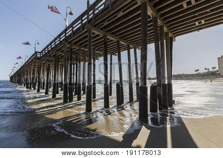 Historic wood pier at Ventura beach in Southern California.