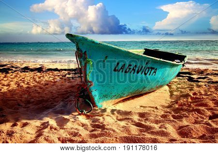 Bavaro beach, Punta Cana, Dominican Republic - July 03, 2016: Fishermen boat on the beach. Some fishermen still use the traditional way of fishing in the Dominican Republic.