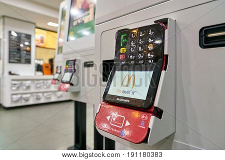 SEOUL, SOUTH KOREA - CIRCA MAY, 2017: close up shot of McDonald's ordering kiosks payment terminal. McDonald's is an American hamburger and fast food restaurant chain.
