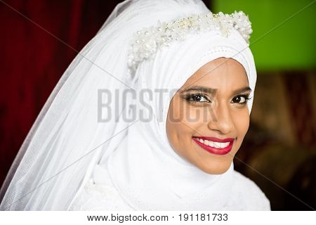Muslim bride young beautiful beauty white wedding dress headscarf portrait smile