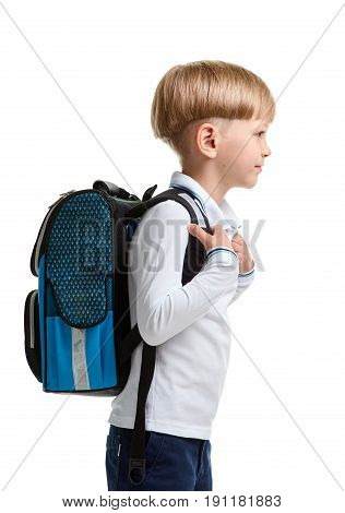 Side view portrait of smiling male pupil with knapsack