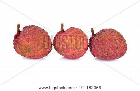 unpeeled ripe lychee fruit on white background