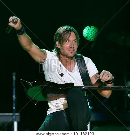 NASHVILLE, TN-JUNE 11: Country singer Keith Urban performs in concert at the CMA Music Festival - Night 4 on June 11, 2017 at Nissan Stadium in Nashville, Tennessee.
