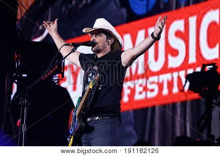 NASHVILLE, TN-JUNE 11: Country singer Brad Paisley performs in concert at the CMA Music Festival - Night 4 on June 11, 2017 at Nissan Stadium in Nashville, Tennessee.