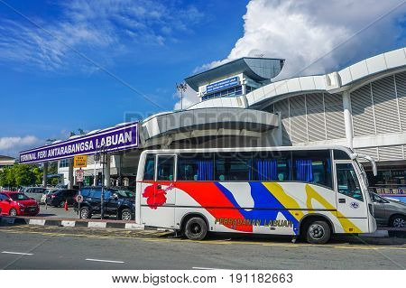 Labuan,Malaysia-May 19,2017:Tourist bus in Labuan International Ferry Terminal at Labuan,Malaysia.Its the cheaper entrance to all visitor to enter Labuan the Pearl of Borneo is through sea transport.