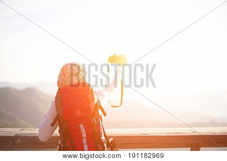 Hiker woman take a photo on the mountain background blue sky Thailand select and soft focus
