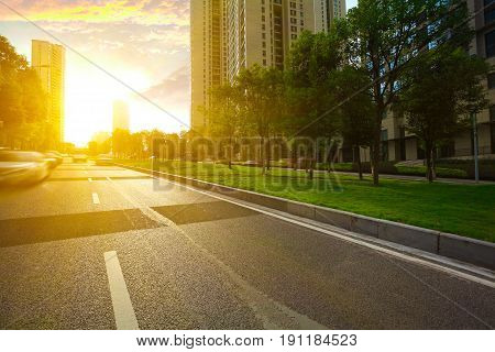 Empty Road Surface Floor With City Streetscape Buildings