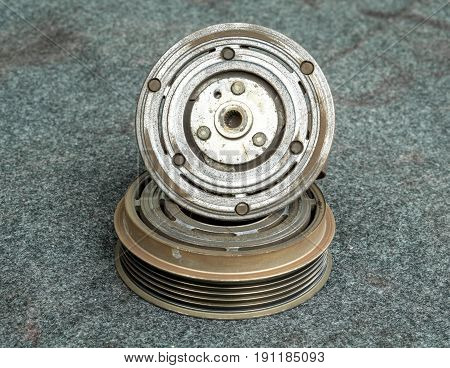 Car part and air conditioner system concept - Closeup old clutch pad on pulley of car air conditioner compressor system and copy space