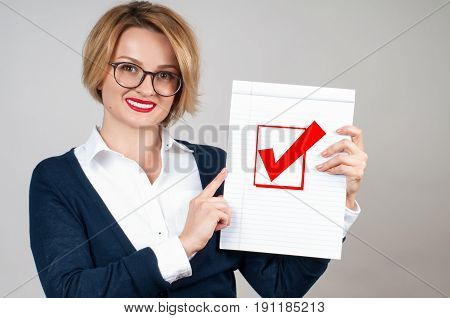 Business Woman Holding Blank Paper With Check