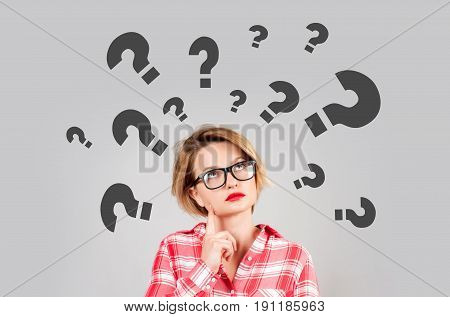 Thinking Women With Question Marks On White Background