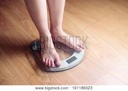 Female Feet Standing On Electronic Scales For Weight Control
