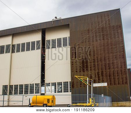 Rusted Side Of Airplane Hangar With Huge Sliding Doors
