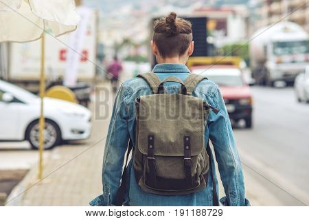Man Traveler With Backpack Explore The Village Walking On The Old Streets And Seeing The Sights