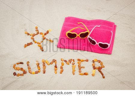 Shape Of Sun And Word Summer With Sunglasses On Sand, Concept Of Sun Protection On Vacation