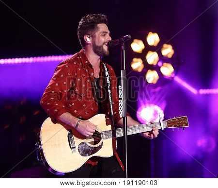 NASHVILLE, TN-JUN 10: Country singer Thomas Rhett performs in concert during the CMA Music Festival on June 10, 2017 at Nissan Stadium in Nashville, Tennessee.