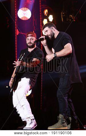 NASHVILLE, TN-JUN 9: Country singer Sam Hunt (R) and Joshua Burkett perform in concert during the 2017 CMA Music Festival on June 9, 2017 at Nissan Stadium in Nashville, Tennessee.