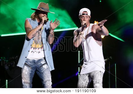 NASHVILLE, TN-JUN 10: Country singers Brian Kelley (L) and Tyler Hubbard of Florida Georgia Line perform in concert at CMA Music Festival on June 10, 2017 at Nissan Stadium in Nashville, Tennessee.